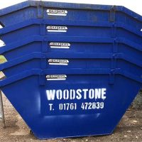 woodstone skip hire blue skips stacked up