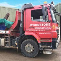 woodstone skip hire skip truck with skip